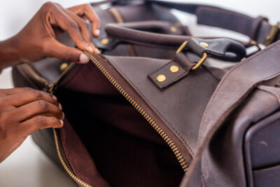 Custom made unisex duffle bag made from dark brown leather