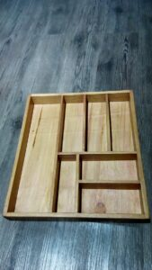Cutlery tray of wood for a kitchen drawer