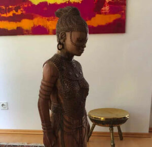 Buddha sculpture (female and African)