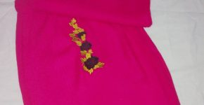 Knitted pink skirt set. With Gold and black embroidered Rose flower