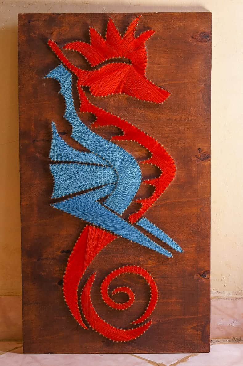 Its a string art piece of the seahorse an animal found deep in the ocean The males are able to give birth This made me want to do a piece of one