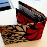 Maßgeschneiderte Ledergeldbörse mit farbenfrohem afrikanischem Muster Fotos vom Kunden
