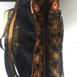 Custom made large handbag into which a 17 inch laptop fits. within custom made realization