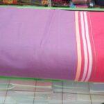 Maßgefertigte Tagesdecke mit passenden Kissenbezügen waehrend der Verhandlung