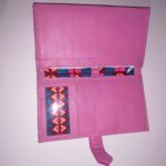 Custom-made leather wallet with a colourfully African pattern within negotiation