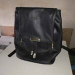 Custom made black leather back pack within custom made realization