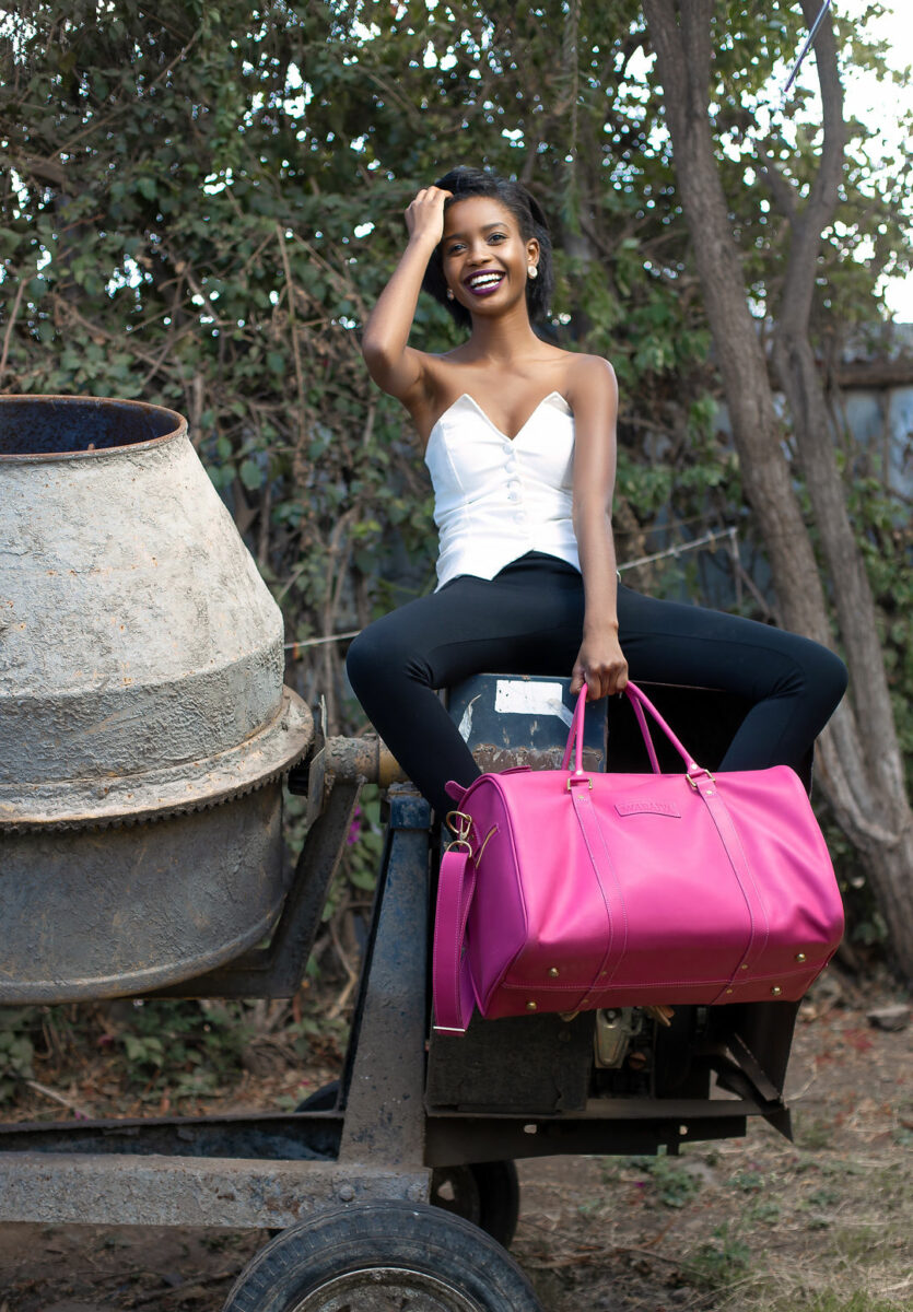 Wabaiya Kariuki (Miss Kenya) likes her first custom made pink leather bag