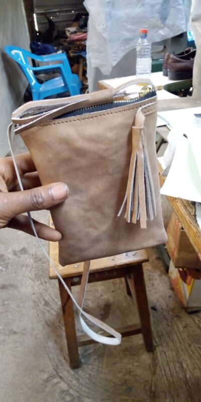 Passport holder made of leather in cognac colour within custom made realization