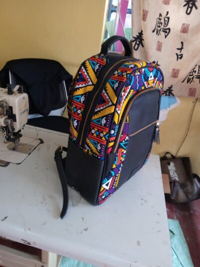 custom made fabric backpack with an extra compartment within custom made realization