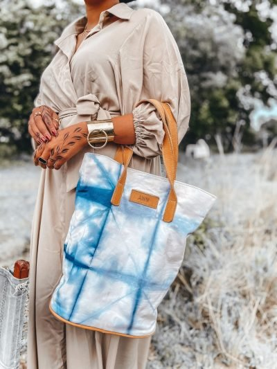 Custom made tie-dye fabric bag with brown leather straps