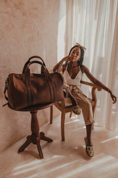 A light tan leather duffle bag - 2 Short straps