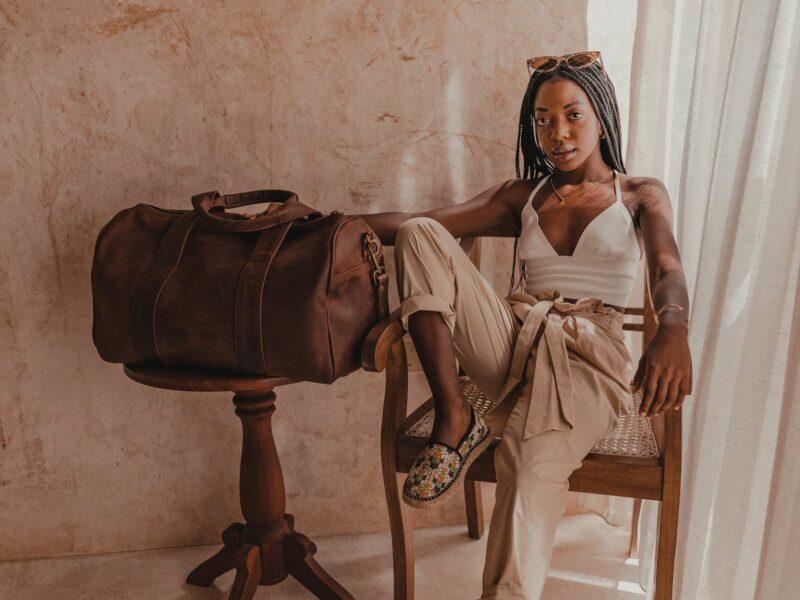 A light tan leather duffle bag – 2 Short straps