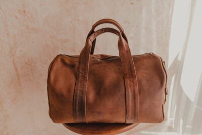A light tan leather duffle bag - 2 Short straps