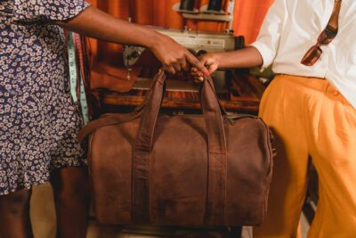A light tan leather duffle bag - 2 Short straps within custom made realization